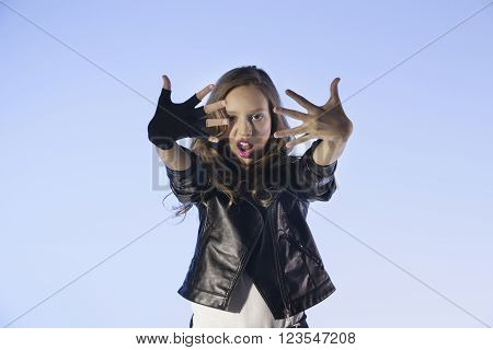 rocker's style caucasian girl on a blue background