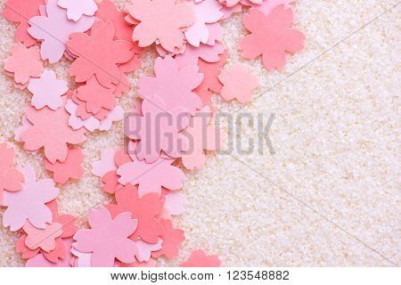 Cherry blossom background image. Cherry blossom abstract background. Sakura or cherry flower shaped paper cutouts on white background.