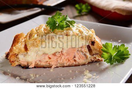 Homemade norwegian salmon baked in pie with rosemary