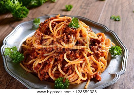 Spaghetti pasta with tomato bolognese sauce and pecorino
