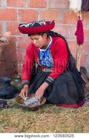 Ollantaytambo, Peru - Circa June 2015: Woman In Traditional Peruvian Clothes Uses Natural Dye For Al