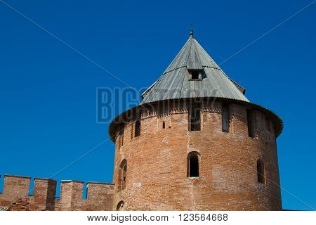 The tower walls of the fortress in the city of Veliky Novgorod. Historic fortress with loopholes, a historical place of Ancient Russia. Tourist destination.