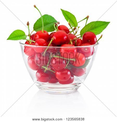 Fresh ripe cherries with leaves in glass bowl isolated on white background