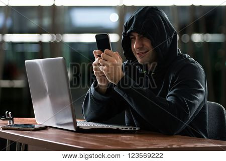 Hacker using a smartphone