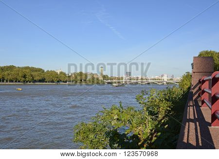 The River Thames at Battersea in London England. Looking across to Chelsea.