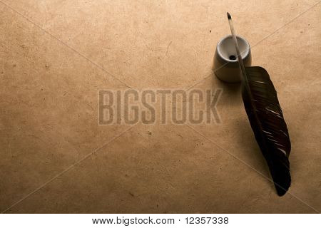 quill pen on vintage paper background