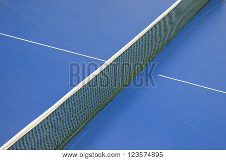 green net for pingpong and blue tennis table