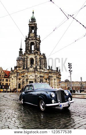 DRESDEN GERMANY - MAY 10: Street view of the Catholic Church of the Royal Court of Saxony (Katholische Hofkirche) and vintage Rolls-Royce in the foreground on may 10 2013 in Dresden Germany.