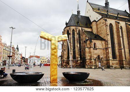 PLZEN CZECH REPUBLIC - JUNE 5: The modern golden fountain on the Republic square on june 5 2013 in Plzen Czech republic.