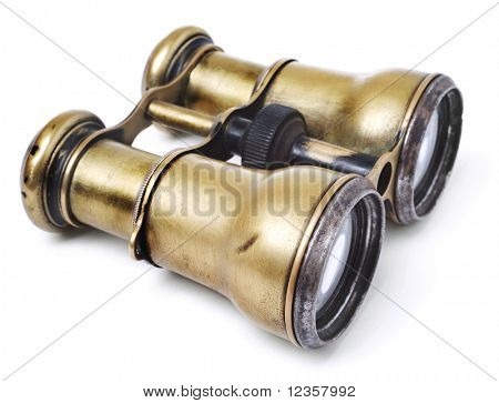 Old brazen binoculars on white background