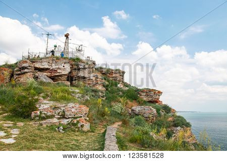 Touristic viewpoint with ordinary tourists on the tip of Kaliakra headland Bulgaria