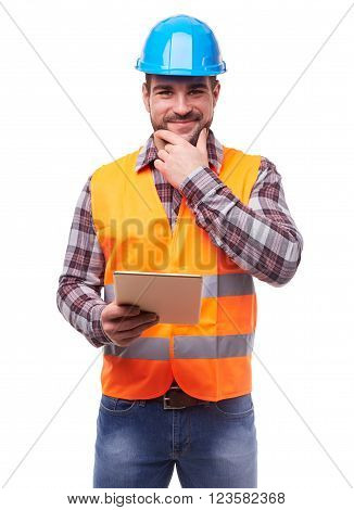 Manual worker in blue helmet with digital tablet isolated on white.