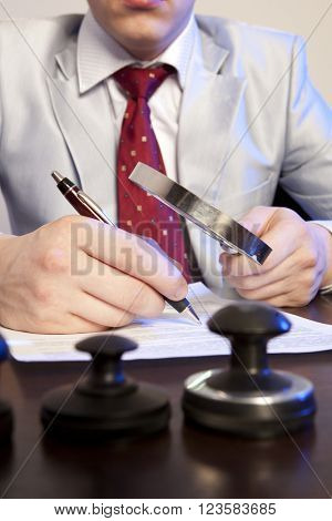 Lawyer, notary signs the documents from our office