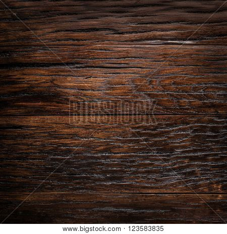 Wooden background painted in the dark brown color.