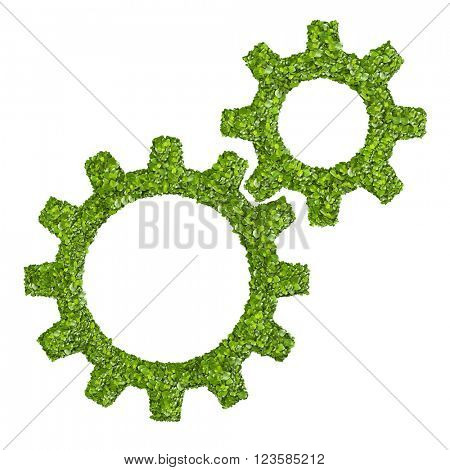 cogs or gears from the green grass. Isolated on white