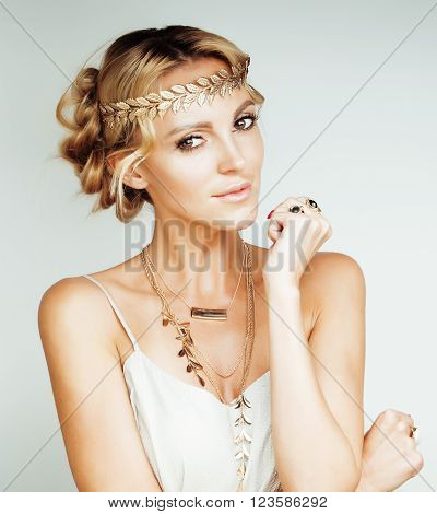 young blond woman dressed like ancient greek godess, gold jewelry close up isolated, beautiful girl hands manicured red nails