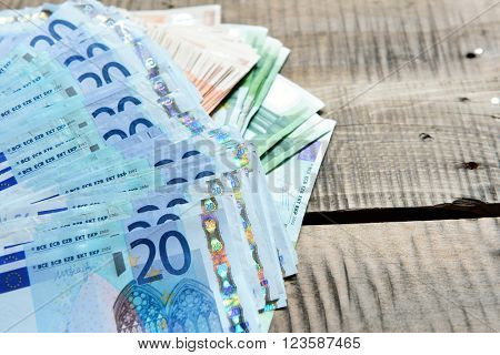 Background with money. Euro cash over wooden background.