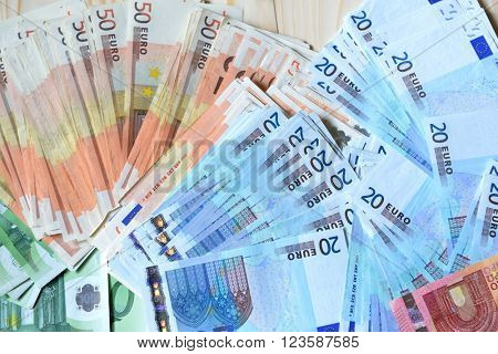 Background with euro money. Euro cash over wooden background.