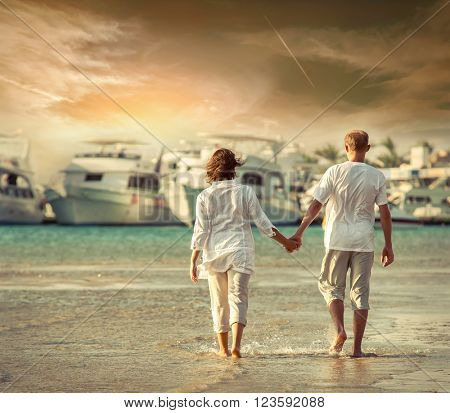 Couple on the sea beach under sunlight