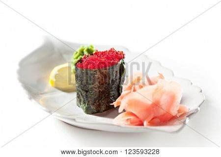 Tobiko Gunkan Sushi Garnished with Ginger and Wasabi