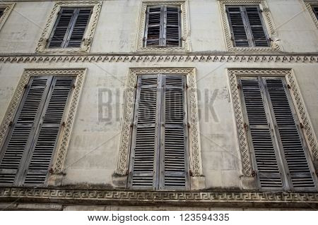 Shutters of an old classic and abandoned haouse
