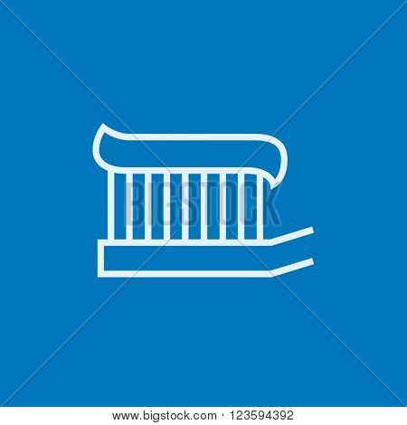 Toothbrush with toothpaste line icon.