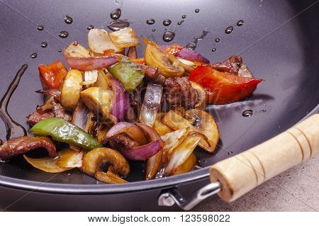 vegetables with meat in a pan close-up during the preparation of meals