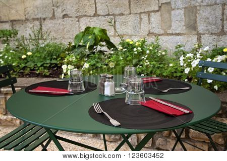 Table set up on the terrace of a French bistro