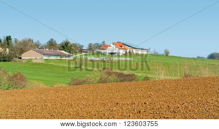 idyllic farm and farmland seen in Southern Germany