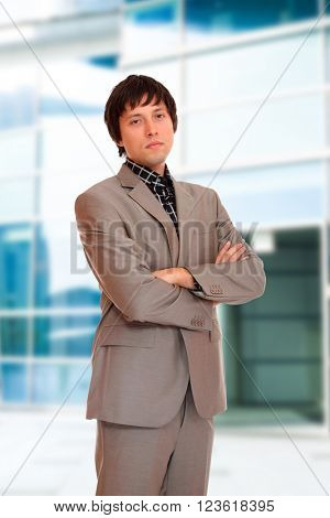 Business man outdoors over city background
