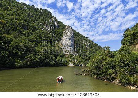 Statue of Decebal carved in stone over Danube river