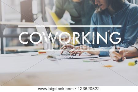 Team succes, coworking world. Photo young business managers  working with new startup project in modern loft. Analyze plans. Contemporary notebook  wood table, typing laptop, papers, documents.