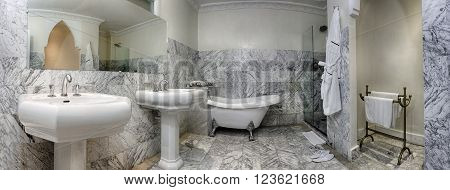 Spacious bathroom of a luxury suite in moroccan style