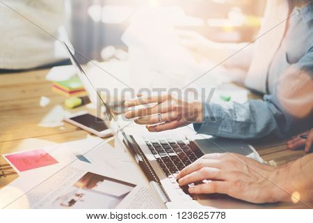 Accounting business meeting concept. Photo young businessman crew working with new startup project in modern loft. notebook on wood table, smartphone