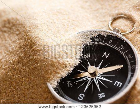 Black Compass In Beach Sand