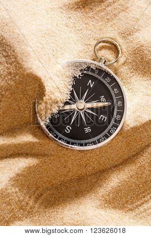 Black Compass In Beach Sand