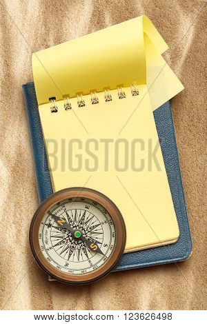 Vintage Compass And Blank Yellow Notepad