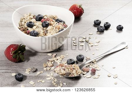 Diet weight loss breakfast, healthy life concept with home made muesli with fresh fruits on a wooden table