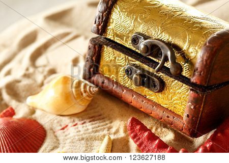 Treasure Chest With Seashells On Sand