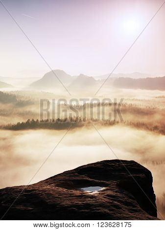 Fantastic Sunrise On The Top Of The Rocky Mountain With The View Into Misty Valley