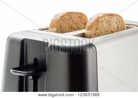 Electric toaster with two wholemeal bread slices close up isolated on white background.