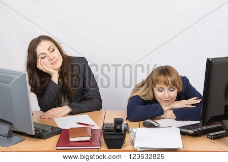 Two Young Office Worker Sleeping On The Job
