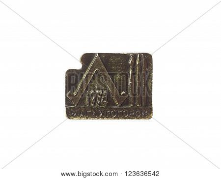 Lapel badge with Magnitogorsk city symbol. Isolated on white.