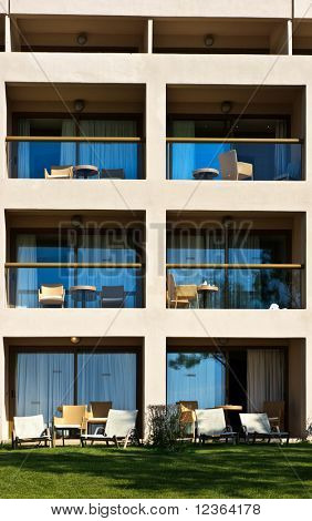 Empty balconies with chairs and tables at Greek hotel