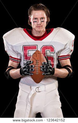 American football player. Studio shot over black.