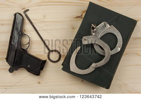 Crime and Punishment. Equipment criminals. The Book of of laws with handcuffs. Law and order.