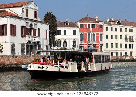 Venice, Italy - March 17, 2016: Vaporetto (water bus) at Venice canal. Vaporettos are a traditional, flat-bottomed Venetian motor boat, well suited to the conditions of the Venetian lagoon