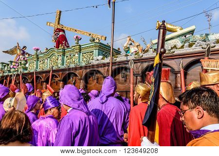 Antigua Guatemala - March 24 2016: Penitents called cucuruchos carry float with Jesus in Holy Thursday procession in colonial town with most famous Holy Week celebrations in Latin America.