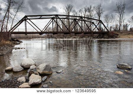 Old vintage trestle bridge accross the river.