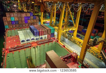 Lift Up Containers From Cargo Ship To The Truck